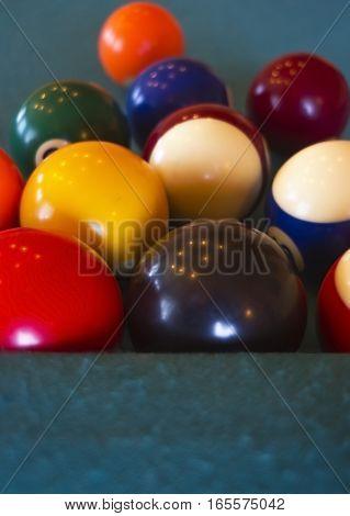 Billiard balls group on the pool table.