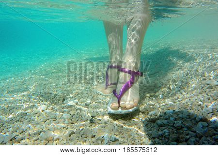 Female Feet In Water