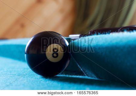 Black billiard ball near the middle pocket.