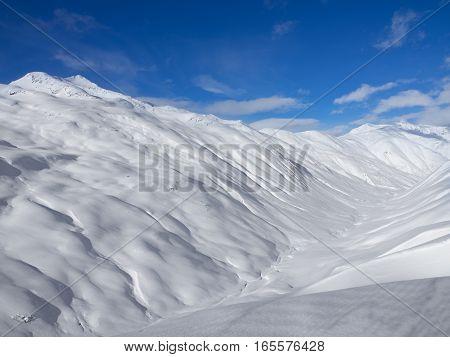 Winter mountains, ski run in Italian Alps, Livignio