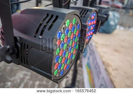 Close up of stage color light source switched on