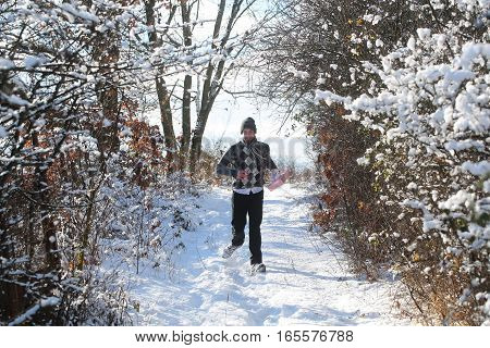 Happy Man With Present In Winter