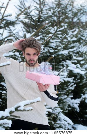 Man With Present In Forest