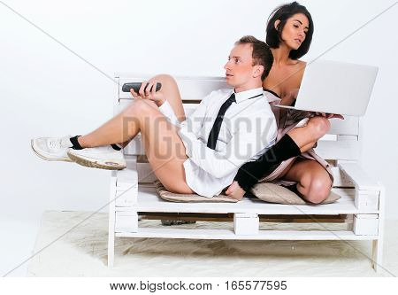 Couple With Laptop And Remote