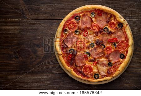 Homemade Pizza With Ham, Cheese, Tomatoes, Olives On Vintage Wooden Background.