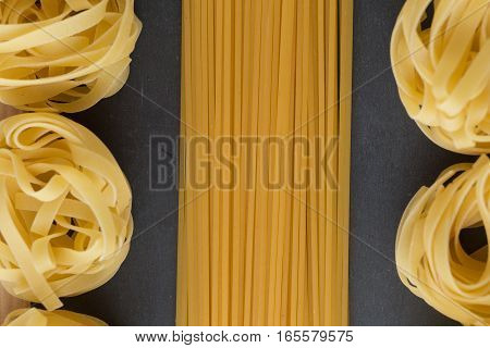 Various Mix Of Pasta Raw Closeup Background. Delicious Dry Uncooked Ingredient For Traditional Itali