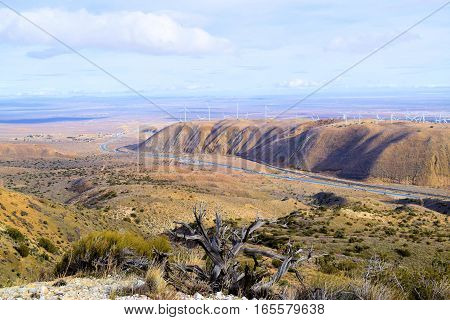 Barren and desolate landscape with sagebrush and chaparral plants overlooking the Mojave Desert taken in Tehachapi Pass, CA