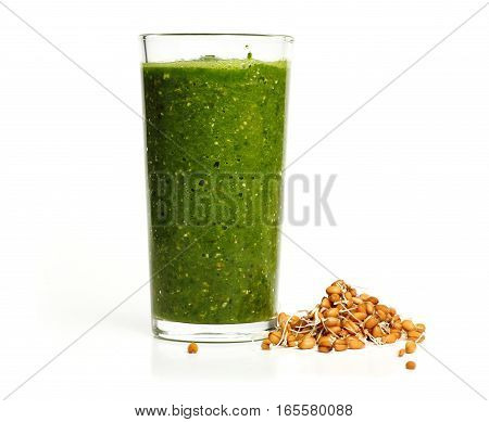 Glass with herbs, spinach, mint, kiwi and sprouted wheat smoothie isolated on white background