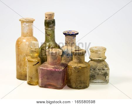 Old styled dirty glass bottles for laboratory use