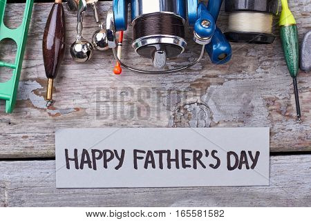 Father's Day card and tackle. Greeting paper and fishing equipment. Great present for dad.
