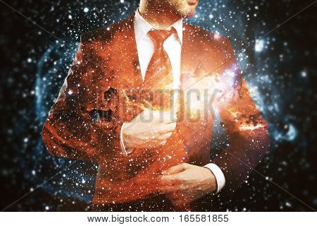 Confident man in suit on abstract space background. Double exposure.