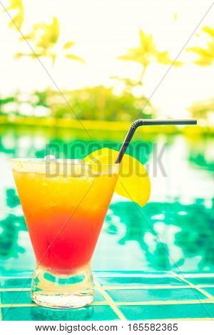cocktail in a glass goblet with a view of the beach