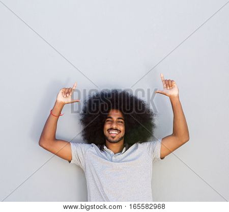 Laughing Young Man With Outstretched Arms And Afro