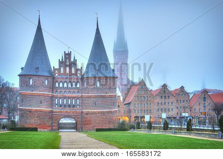 Holsten Gate Of Lubeck In Germany At Dawn