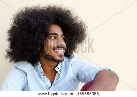 Happy Afro Man Sitting And Looking Away