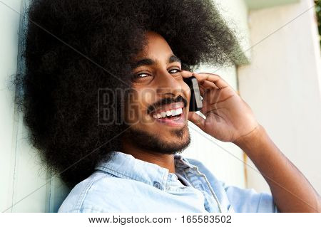 Happy Afro Man Talking On Mobile Phone And Smiling