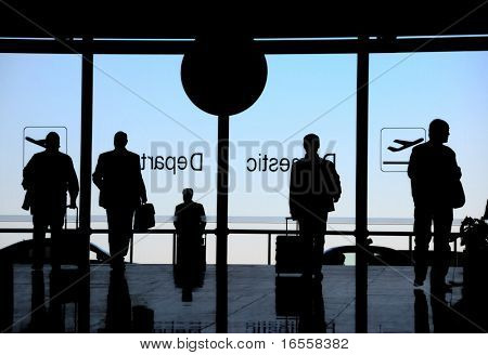 Business travelers moving in airport