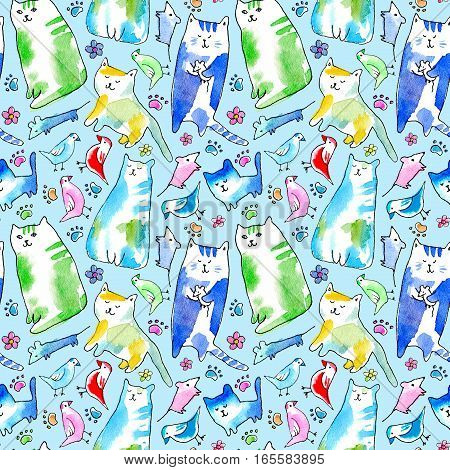 Seamless pattern of a cat, bird, mouse, flower and paw. Watercolor hand drawn illustration.Blue background.
