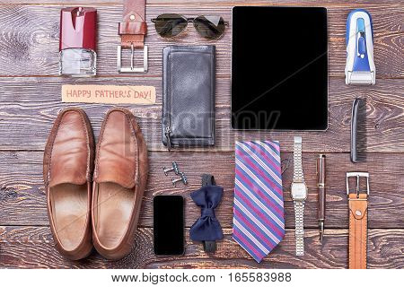 Accessories and Father's Day card. Gadgets, wallet and shoes. Complete dad's look by accessories.