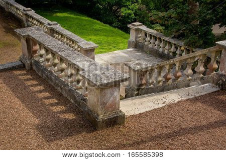 old stone stairs with railings and balusters