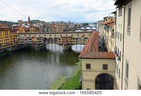 Ancient Bridge Called Ponte Vecchio And Vasari Corridor In Flore