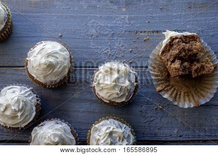 fresh baked cupcakes on a blue rustic table