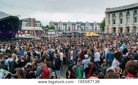 Bristol UK - July 16 2016: An audience at the Cascade Steps stage shows its appreciation for one of the bands at the annual Harbour Festival in Bristol UK