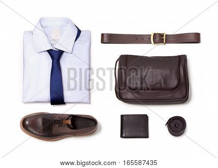 The layout on a white background. Shirt tie belt purse and shoes