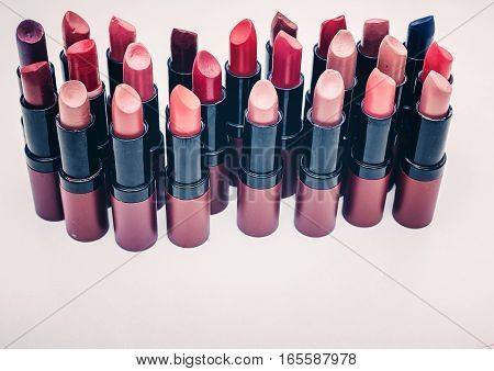 Lipsticks of different colors. A lot of lipsticks in different shades to choose from.
