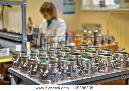 St. Petersburg Russia - September 3 2015: Electronic assembly equipment worker makes expertise industrial instruments.