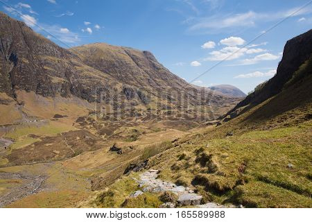 Scottish mountains in spring with sunshine Glencoe Scotland UK stunning beautiful Scottish glen in Lochaber famous tourist destination