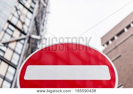 No Entry sign in front of buildings in London