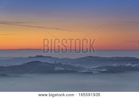 Sunset Over Misty Valleys