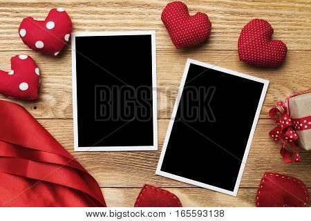 Blank instant photo and love hearts on wooden table background
