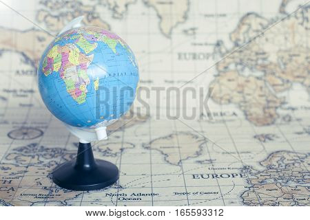 Travel adventure tourism traveling traveler concept with world map