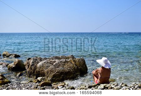 Woman relaxing on the beach in Adriatic Sea