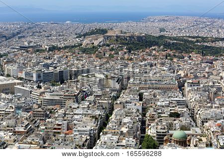 ATHENS GREECE - MAY 02: Aerial Cityscape of Athens on MAY 02 2015. Acropolis UNESCO World Heritage Site and City From Mount Lycabettus in Athens Greece.
