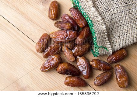 Dried Date Fruits On Wooden Table