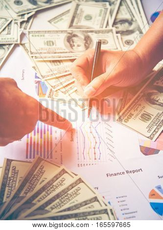 Business concept with money and documents graph report finance