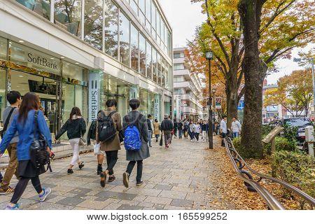 Tokyo Japan - November 20 2016 :Pedestrians crowded at Harajuku Tokyo Japan . Harajuku is known internationally as a center of Japanese youth culture and fashion.