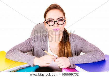 Woman working in office. Businesswoman or secretary with many documents folders bills on her desk working. College workplace education concept.