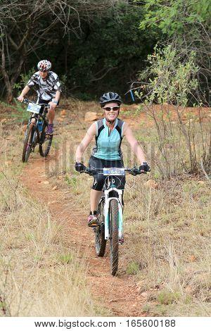 Women Enjoying Outdoors Ride At Mountain Bike Race