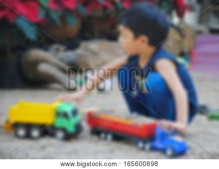 Abstract Blur image of Kids play car toy