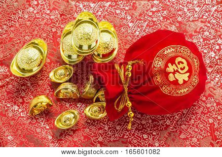 Chinese New Year Decoration,close Up Red Fabric Packet Or Ang Pow With Chinese Style Pattern And Gol