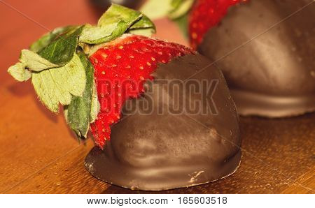 Valentine's Day romance food Rich chocolate covered strawberry for sweet romantic dessert Image with room for copy or greeting card message or promotion for social share
