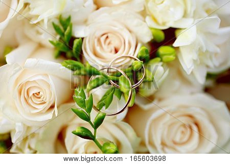 Wedding rings close-up on bouquet. Wedding decor