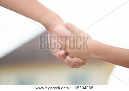 Two little kids holding hands and holding hands walking. The media love ties and caring to step into the vast world.
