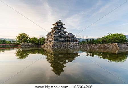Matsumoto castle reflect on water in evening at nagano japan