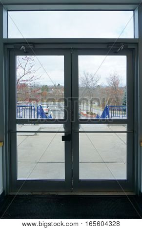 Looking through glass door of office to the exterior parking area