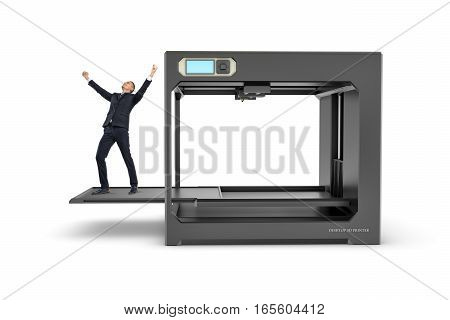 Small businessman with hands raised in victory standing on a pulled out printing bed of a 3D-printer. 3d-printing. Business and success. New business ideas.